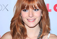 Bella-thorne-blue-eye-makeup-for-red-hair-side